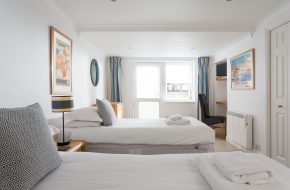 Twin bedroom at Anchor, self-catering holiday cottage in Rock, Cornwall