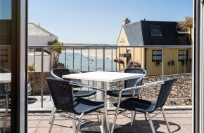 The balcony and view from Captains, self-catering holiday cottage in Rock, Cornwall
