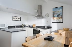 Kitchen and dining space at Captains, self-catering cottage in Rock, Cornwall