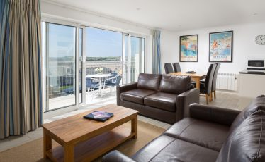 Lounge with sea views at Gull House, self-catering cottage in Rock, Cornwall