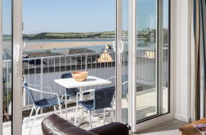 Balcony with sea view at Heron House, self catering cottage in Rock, Cornwall