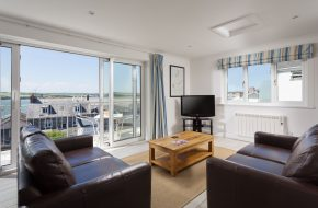 Lounge with sea views at Heron House, self catering cottage in Rock, Cornwall
