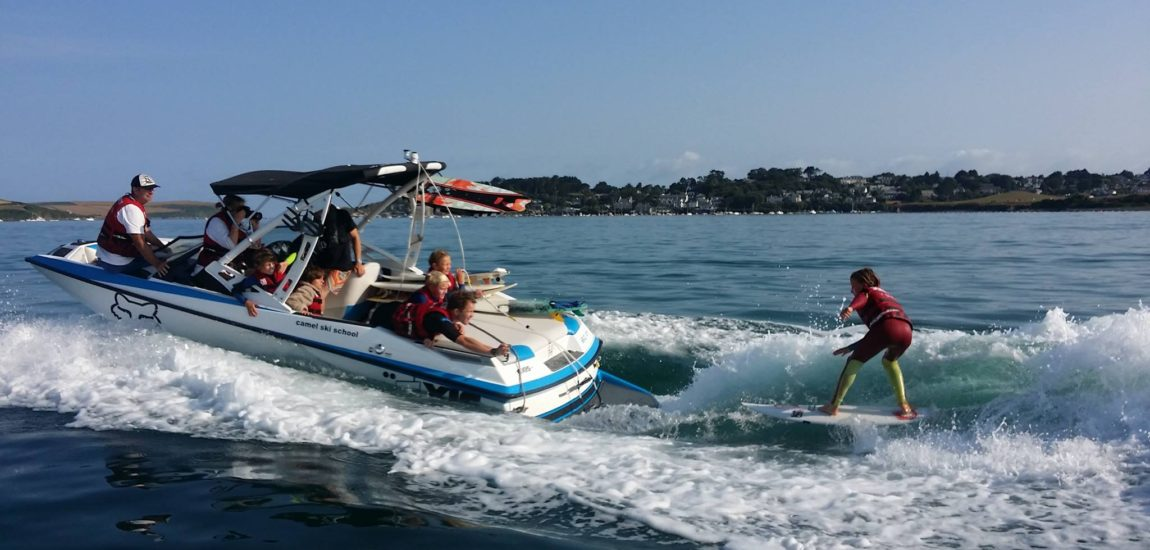 A wakesurf session underway with Camel Ski School. Water sports on the camel estuary are a common sight.