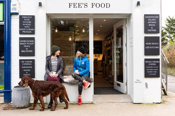 Fees food with some customers outside. Fees food supplies a range of delicious lunchtime snacks and homemade meals for a quick and easy dinner.
